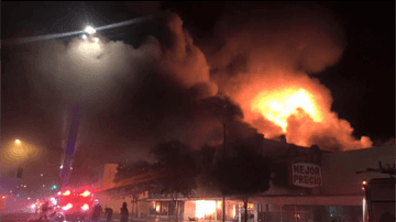Large Smoke and Fire On Building Plaza During Evening Time
