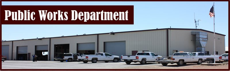 Public Works Header Photo with Trucks at Large Facility